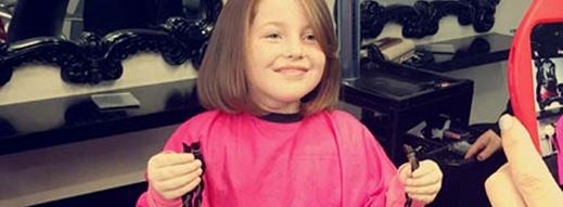 8yr old girl chops hair for cancer charity