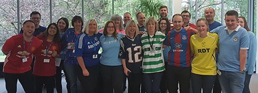 Football shirts to work raises £340 for Cancer Research UK
